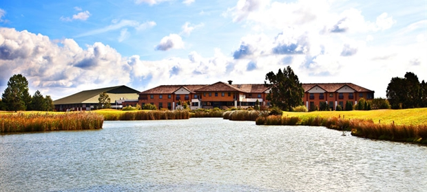 Crowne Plaza Colchester exterior venue and lake