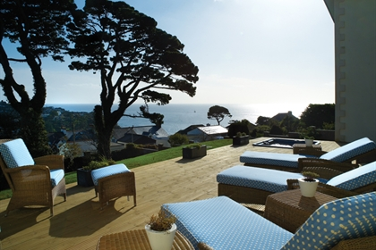 Fowey Hall outdoor loungers and view