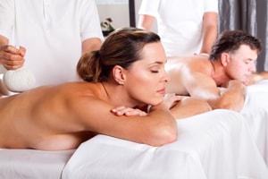 A couple having a back massage